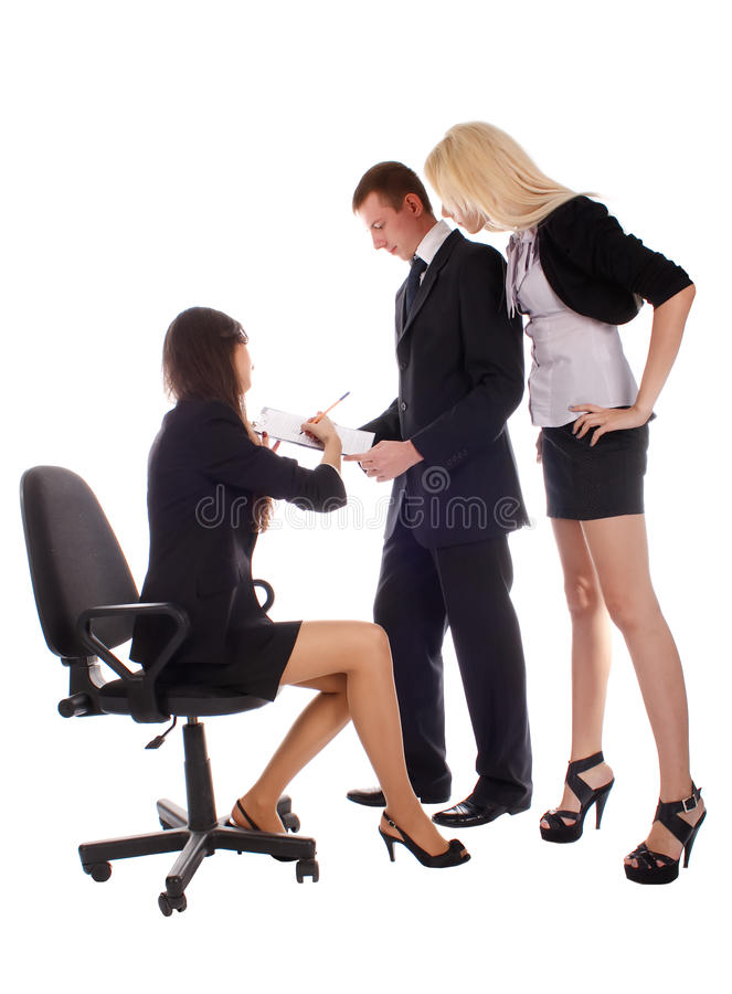 Women show in document to bussines men and women royalty free stock image