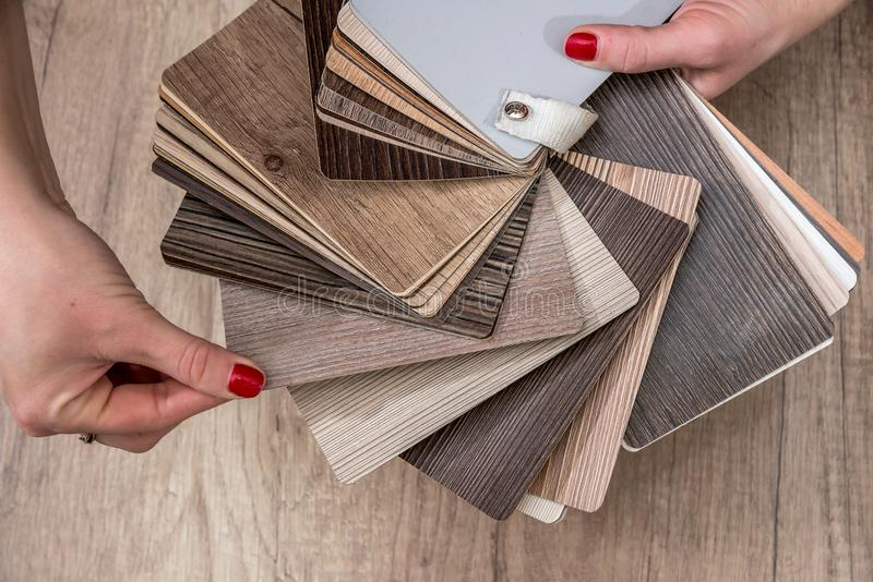 Women showing Samples of laminate. And vinyl floor tile royalty free stock images