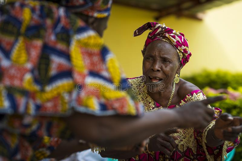 Women singing and dancing traditional songs at a community meeting in the city of Bissau, Guinea-Bissau. Bissau, Republic of Guinea-Bissau - January 31, 2018 stock photo