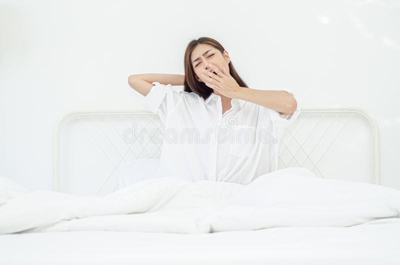 Women sit at the edge of the bed royalty free stock image
