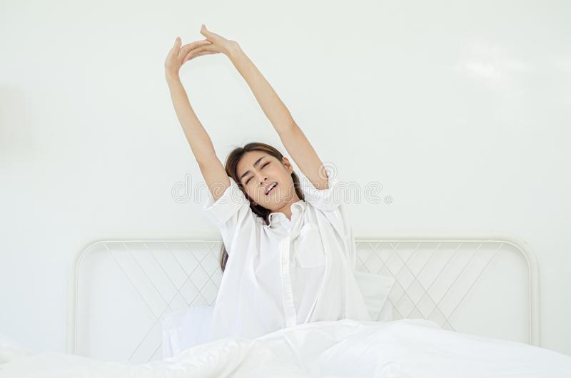 Women sit at the edge of the bed stock photography