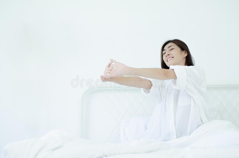 Women sit at the edge of the bed stock photos