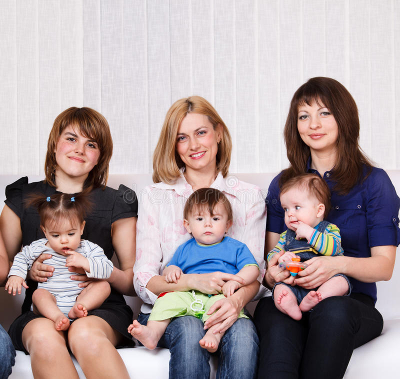 Women sitting with babies royalty free stock photography