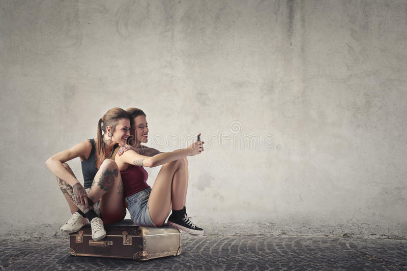 Women sitting on a bag royalty free stock photo