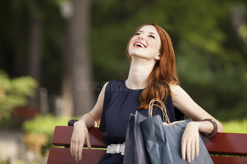 Women sitting on the bench royalty free stock photo