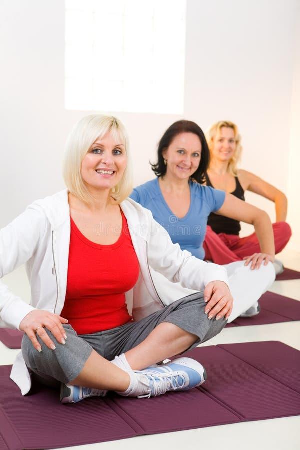 Download Women Sitting Cross-legged On Mat Stock Image - Image: 8869163