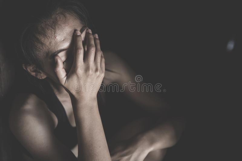Women sitting on the floor crying with depression, Depressed woman, family problems, Stress, kitchen, abuse, Domestic violence, royalty free stock photography