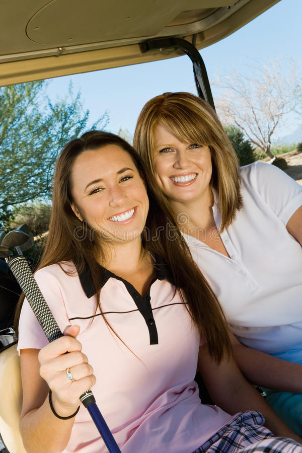 Women Sitting In Golf Cart stock photography