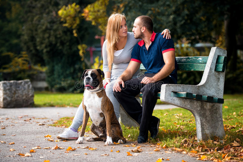 Download Women Sitting Outdoors With Her Pet Dog German Boxer Stock Photo - Image of male, beautiful: 34595376