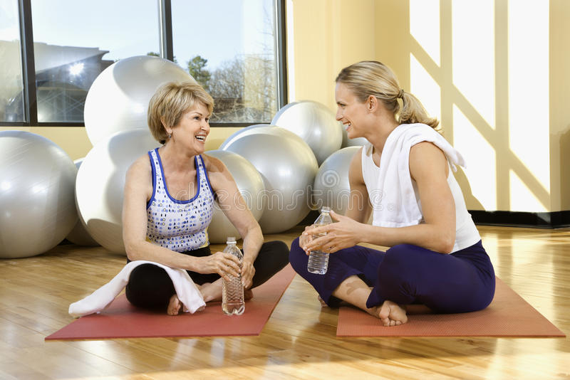 Women Sitting And Socializing At Gym Royalty Free Stock Photos