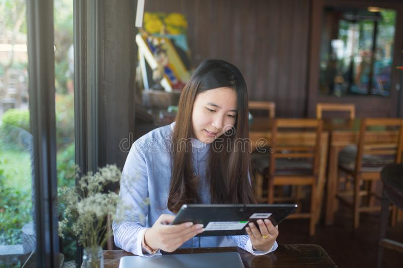 Smart women using laptop and smartphone and technology stock photos