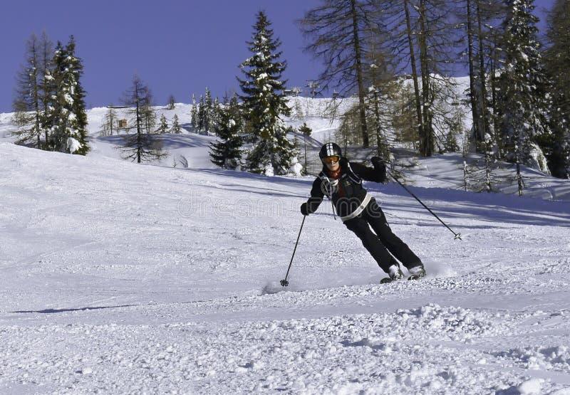 Mature women skiing. Downhill Shuttleberg in Kleinarl ski area, Austria royalty free stock photography