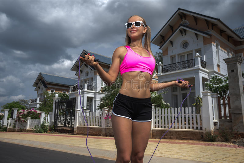 Women with skipping rope. Women jumping with skipping rope royalty free stock photography
