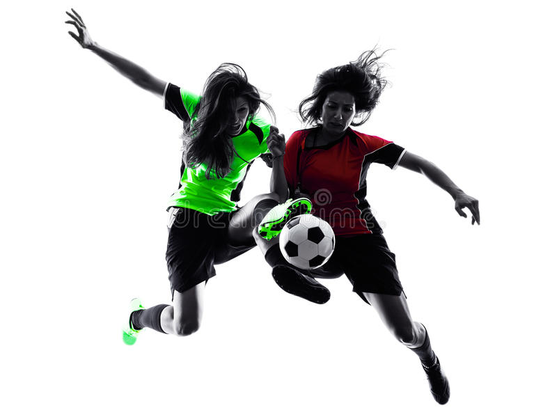Women soccer players isolated silhouette. Two women playing soccer players in silhouette isolated on white background royalty free stock photography