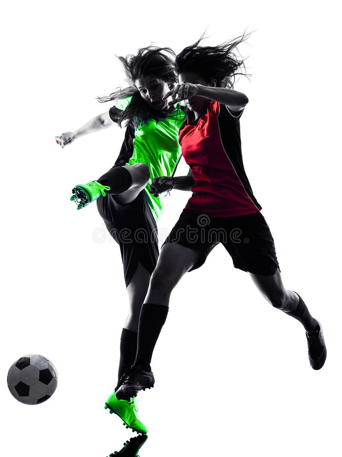 Women soccer players isolated silhouette. Two women playing soccer players in silhouette isolated on white background stock photo