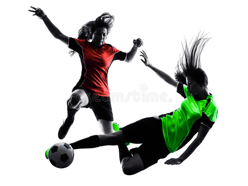 Women soccer players isolated silhouette. Two women playing soccer players in silhouette isolated on white background royalty free stock images