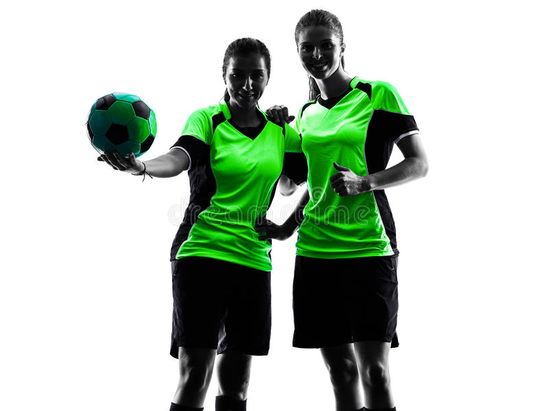Women soccer players isolated silhouette. Two women playing soccer players in silhouette isolated on white background stock photos
