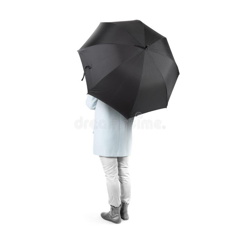 Women stand backwards with black blank umbrella mock up isolated stock photos