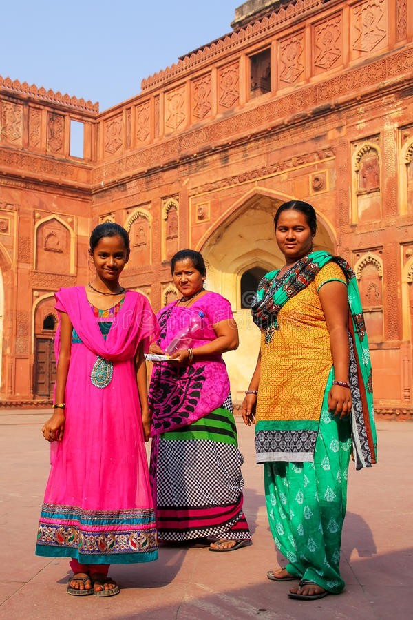 Women standing in the courtyard of Jahangiri Mahal in Agra Fort, Uttar Pradesh, India. The fort was built primarily as a military structure, but was later royalty free stock photo