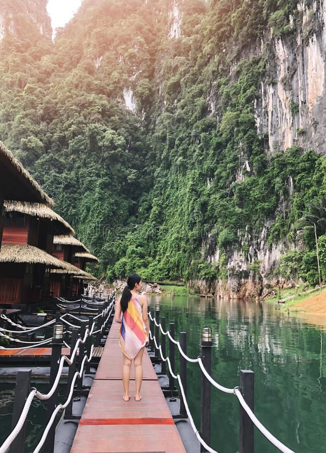Women Standing on the walkway into raft house floating on the river at Khao Sok,Rajjaprabha DamChiao Lan DamSurat Thani , royalty free stock images