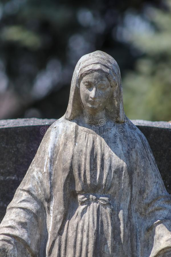 Women statue in front of a headstone. In the clarks Nebraska cemetery royalty free stock image