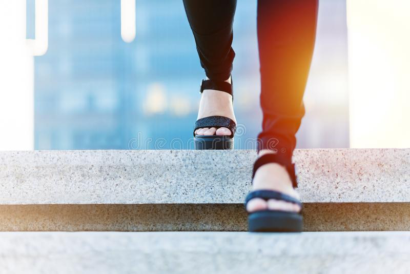 Women step forward to success, business young women is stepping forward on staircase royalty free stock photo