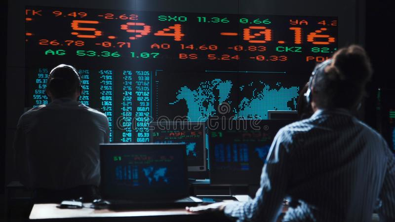 Woman stock broker working in futuristic office royalty free stock photography