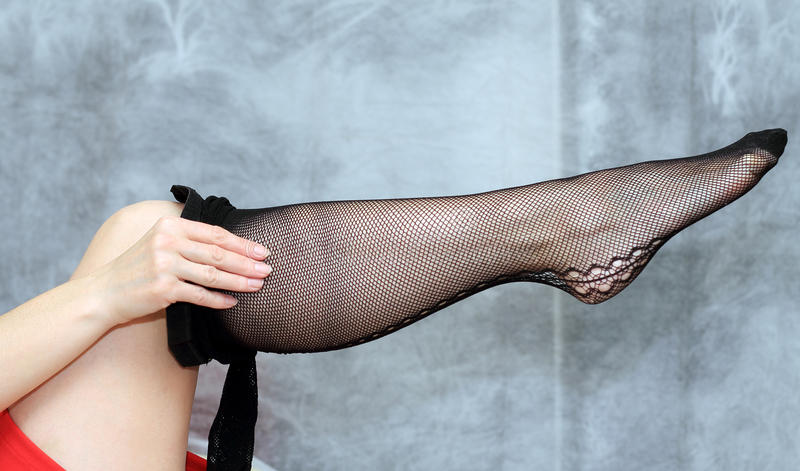 Women in stockings. Woman in stockings on her feet royalty free stock image