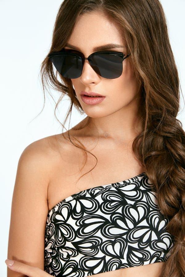 Women Style. Woman In Fashion Sunglasses. stock photo