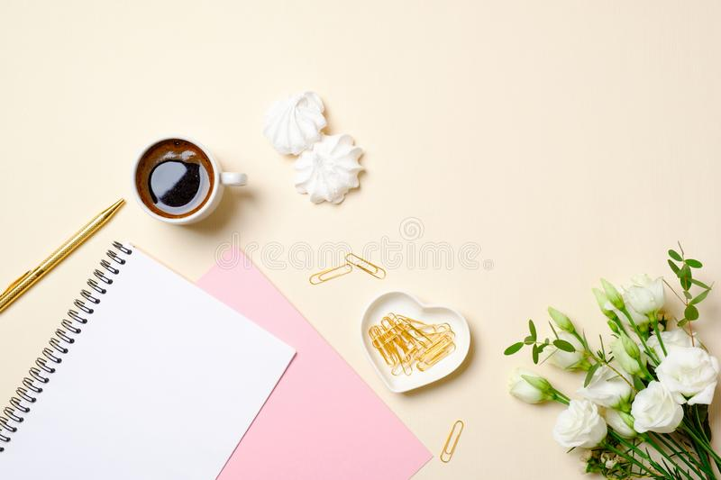 Women table top view, cute feminine stuff on beige background. Home office desk, beauty blogger desktop, girls diary, coffee cup, royalty free stock photography