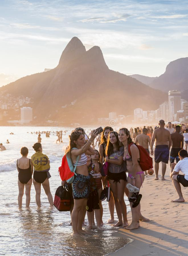 Women take selfie in Ipanema beach, Rio de Janeiro at sunset royalty free stock image