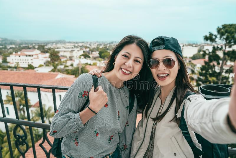 Women taking selfies on the balcony stock photos