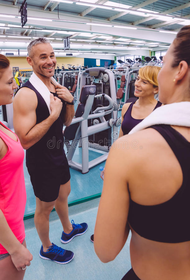 Women talking with personal trainer after training royalty free stock photography