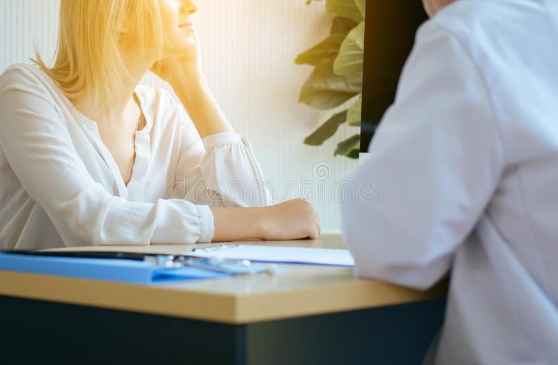 Woman talking to doctor psychiatrist in hospital,Discuss issue and find solutions to mental health problems. Women talking to doctor psychiatrist in hospital stock photos
