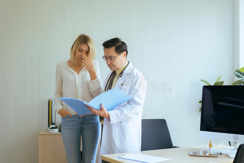 Women talking to doctor psychiatrist in hospital,Discuss issue and find solutions to mental health problems. Woman talking to doctor psychiatrist in hospital royalty free stock image