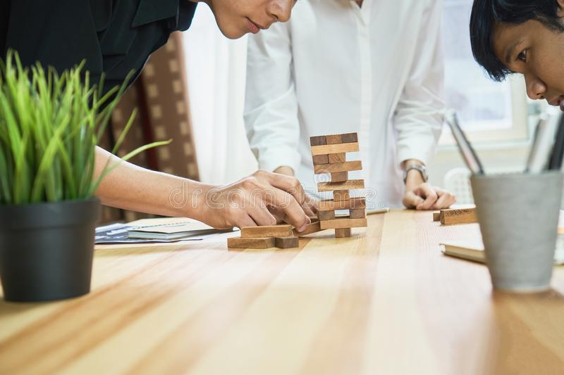Women and teamwork making a pyramid with empty wooden cubes. Business concept with step-by-step for a firm basis stock photo