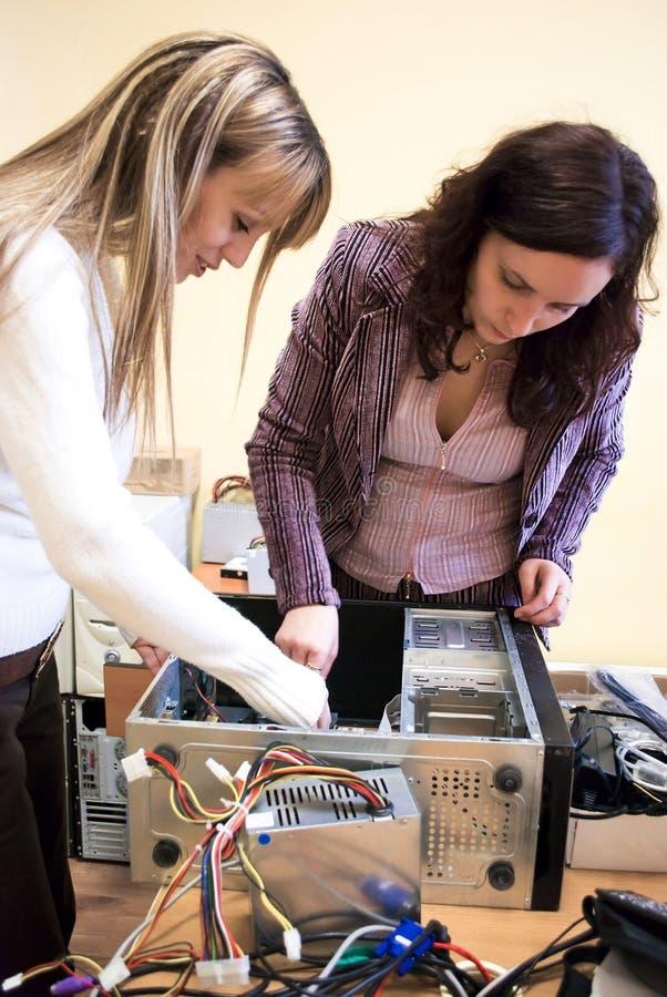 Women technicians royalty free stock photos
