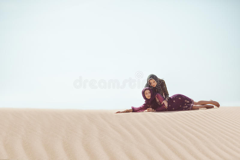 Women thirsty in a desert. Unforeseen circumstances during the travel. stock photos