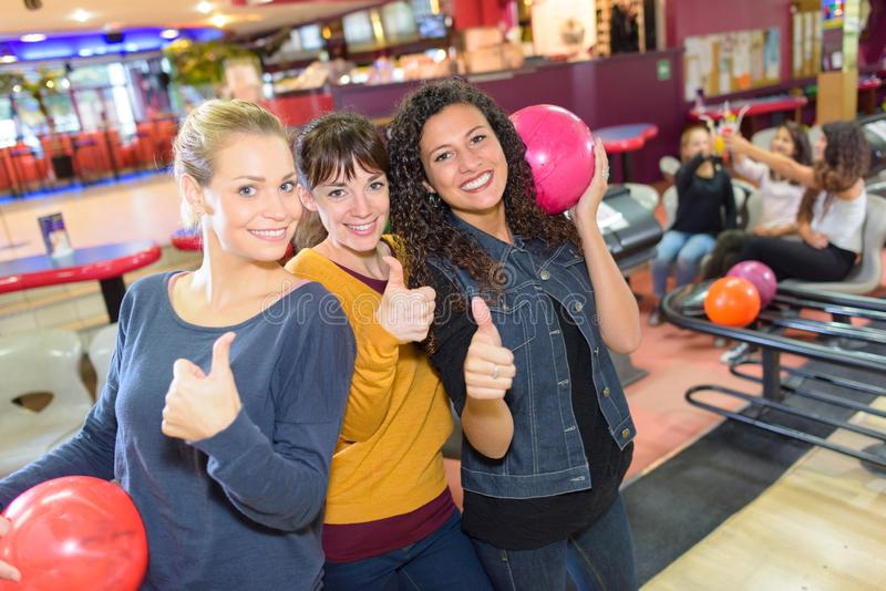 Women with thumbs up in bowling hall royalty free stock photos