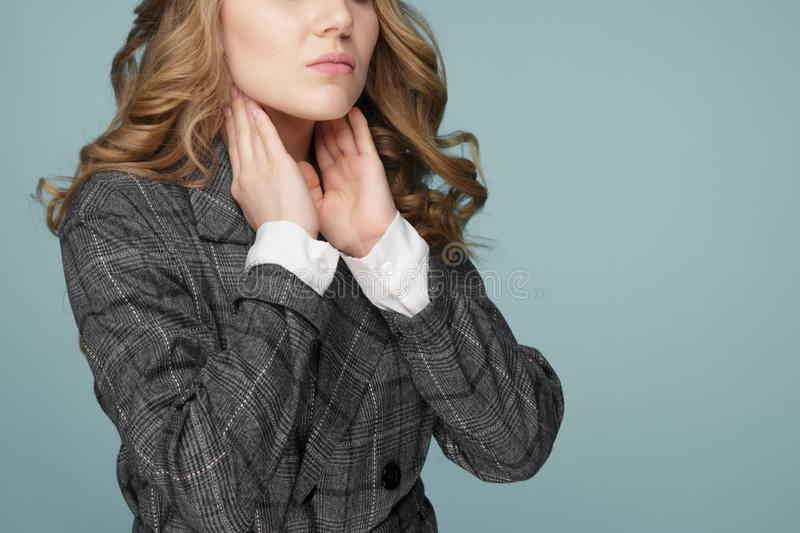 Women thyroid gland control. Sore throat of a people. Isolated on Blue background stock image