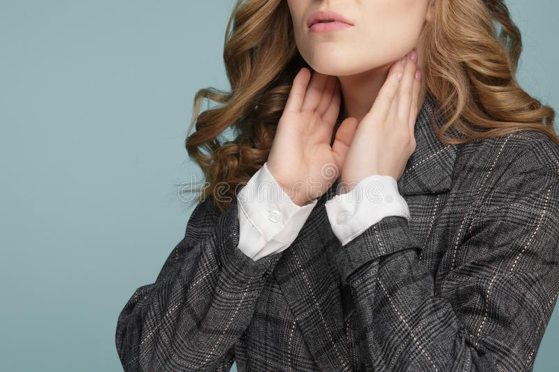 Women thyroid gland control. Sore throat of a people. Isolated on Blue background stock photography