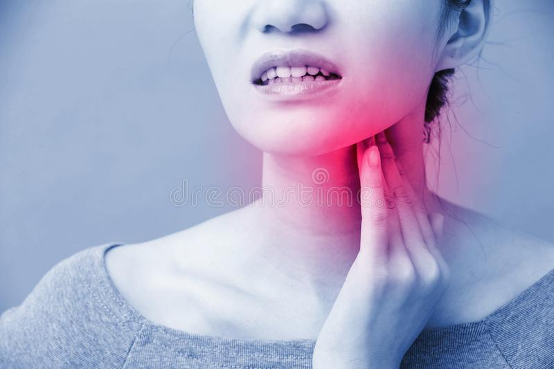 Women with thyroid gland problem. On the blue background stock photo