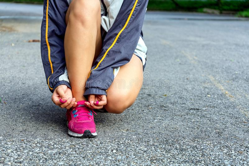 Women are tied to the shoes to prepare for the marathon. stock photos