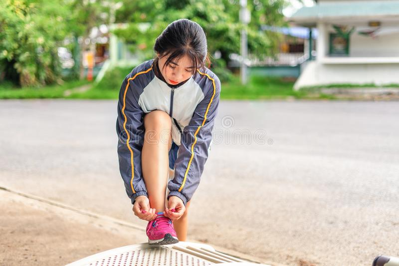 Women are tied to the shoes to prepare for the marathon. royalty free stock images