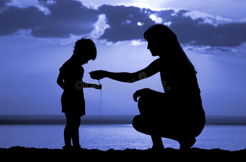 Download Women To Pour Sand In Hand Child Stock Image - Image: 10915169