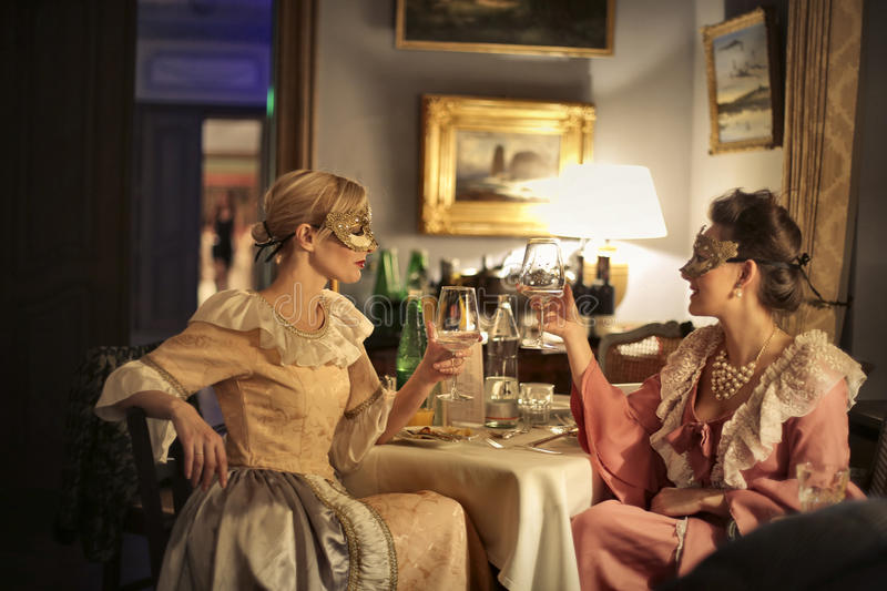 Women toasting on a party stock images