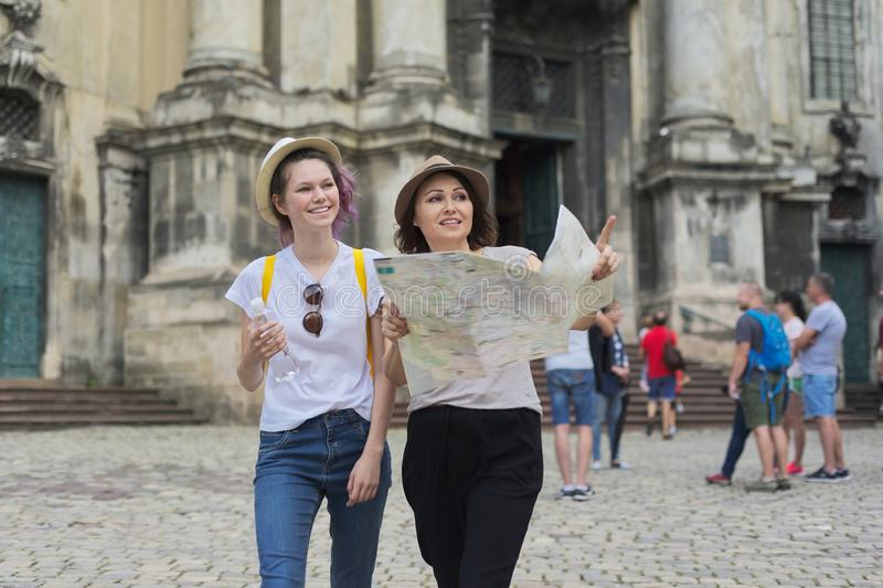 Women tourists mother and daughter teenager with map royalty free stock image