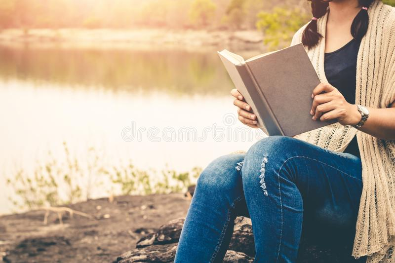 Women tourists read book in the holiday in quiet nature, Concept reading a book royalty free stock photography