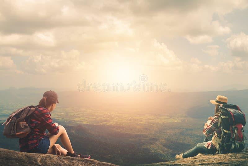 Women tourists walk in the climbing. Women tourists walk in the climbing to nature tours royalty free stock image