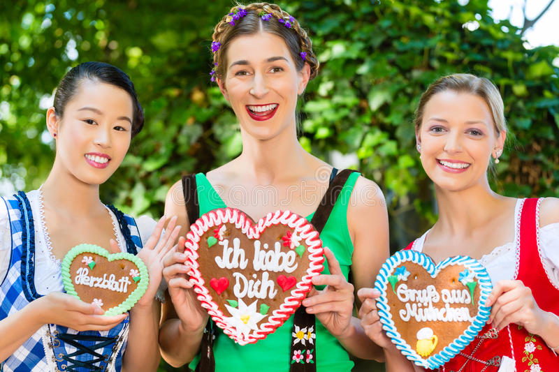 Women in traditional Bavarian clothes in beergarden stock photos